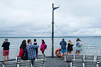 People ride a ferry between Falmouth and Vineyard Haven, Martha's Vineyard, Massachusetts, USA, on Tues., July 25, 2017.