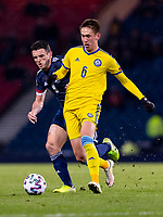 19th November 2019; Hampden Park, Glasgow, Scotland; European Championships 2020 Qualifier, Scotland versus Kazakhstan; Aybol Abiken of Kazakhstan and John McGinn of Scotland compete for possession of the ball - Editorial Use