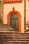 Steps leading up to a green door in Blevio, a town on Lake Como, Italy