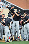 Wake Forest Demon Deacons head coach Tom Walter (right) jumps into pitcher John McCarren (45) prior to the game against the West Virginia Mountaineers in Game Six of the Winston-Salem Regional in the 2017 College World Series at David F. Couch Ballpark on June 4, 2017 in Winston-Salem, North Carolina.  The Demon Deacons defeated the Mountaineers 12-8.  (Brian Westerholt/Four Seam Images)