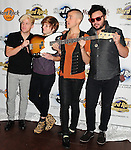 HOLLYWOOD, FL - OCTOBER 11: Chris Allen, Elaine Bradley, Tyler Glenn and Branden Campbell of Alternative rock band Neon Trees donate sign bass guitar memorabilia  to Hard Rock Hotel at Hard Rock Cafe! in the Seminole Hard Rock Hotel & Casino on October 11, 2011 in Hollywood, Florida. (Photo by Johnny Louis/jlnphotography.com)