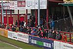 Altrincham 2 Worcester City 0, 23/03/2013. Moss Lane, Blue Square Bet North. Home team supporters watching the action during the second-half of the the Blue Square Bet North fixture between Altrincham (in red) and Worcester City at Moss Lane, Altrincham. The home team won the match 2-0 watched by 777 spectators on a day when most non-League football in England was cancelled due to adverse weather. Altrincham were historically one of the major English non-League teams but have never been promoted to the Football League. Photo by Colin McPherson.