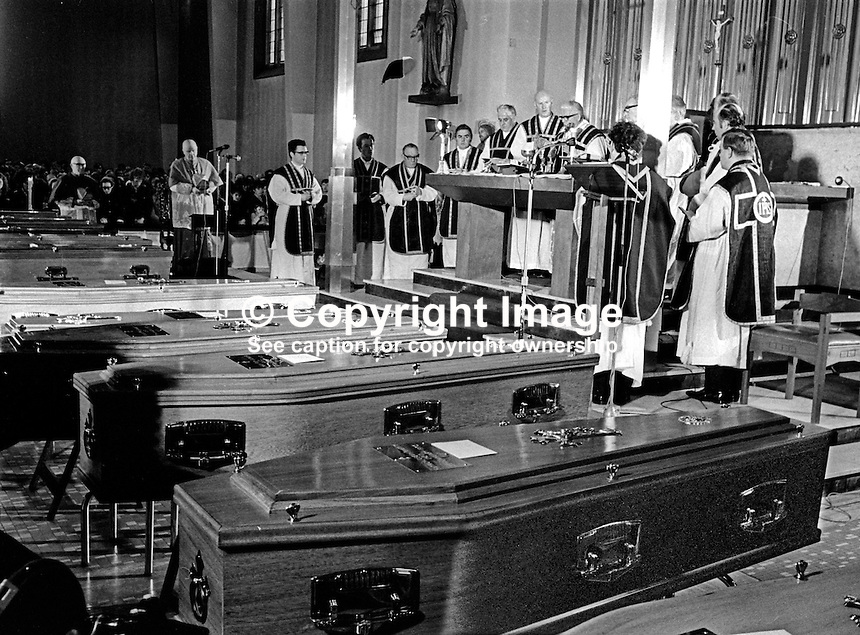 A funeral mass for eleven of the 13 Bloody Sunday victims taking place in St Mary's Roman Catholic Church, Creggan, Londonderry. The funerals of the other two victims took place in the Waterside and in Donegal. 197202020069d, 69/72<br />