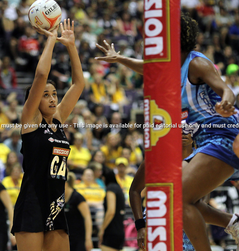 04.07.2011 Silver Ferns Maria Tutaia in action during netball match between Silver Ferns and Fiji at the Misson Foods World Netball Championship 2011 held at the Singapore Indoor Stadium in Singapore . Mandatory Photo Credit ©Michael Bradley.