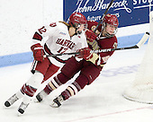 Samantha Reber (Harvard - 12), Taylor Wasylk (BC - 9) - The Boston College Eagles defeated the Harvard University Crimson 4-2 in the 2012 Beanpot consolation game on Tuesday, February 7, 2012, at Walter Brown Arena in Boston, Massachusetts.