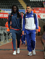 L-R Bafetimbi Gomis of Swansea and Kenedy of Chelsea arrive before the Barclays Premier League match between Swansea City and Chelsea at the Liberty Stadium, Swansea on April 9th 2016