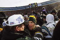 Green Bay Packers Coach Mike Holmgren and quarterback Brett Favre embrace after the Packers defeated the Carolina Panthers 30-13 in the NFC Championship at Lambeau Field on January 12, 1997.