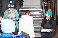 """A campaign volunteer wearing a beanie reading """"Warren has a plan for that"""" checks in attendees before Democratic presidential candidate and Massachusetts senator Elizabeth Warren files paperwork to get on the primary ballot at the NH State House in Concord, New Hampshire, on Wed., November 13, 2019. Warren also held a small rally outside the State House after filing her paperwork."""