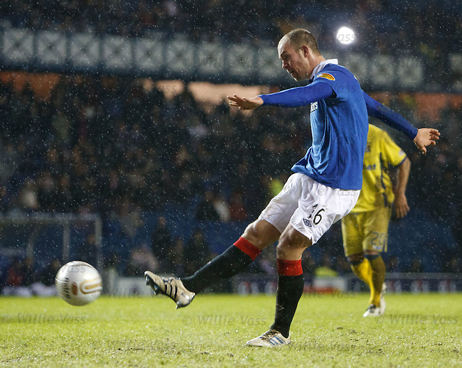 Steven Whittaker lashes away the penalty to put Rangers 3-0 up
