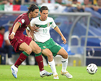 Simao Sabrosa (11) of Portugal and Guillermo Franco (10) of Mexico. Portugal defeated Mexico 2-1 in their FIFA World Cup Group D match at FIFA World Cup Stadium, Gelsenkirchen, Germany, June 21, 2006.