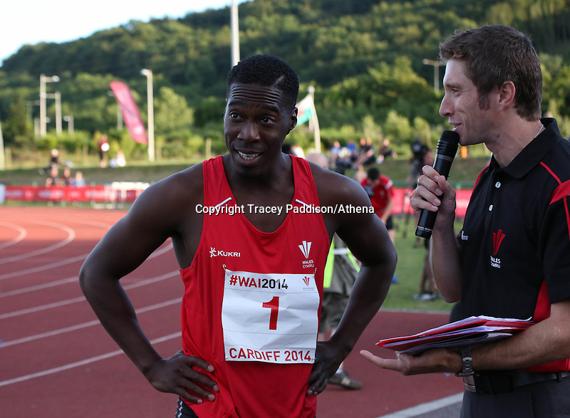 Tuesday 15th July 2014<br /> Pictured: Christian Malcolm<br /> RE: Welsh sprinter Christian Malcolm with a commentator  after running his last race on home soil at the Welsh Athletics International in the Cardiff International Sports Stadium, South Wales, UK.