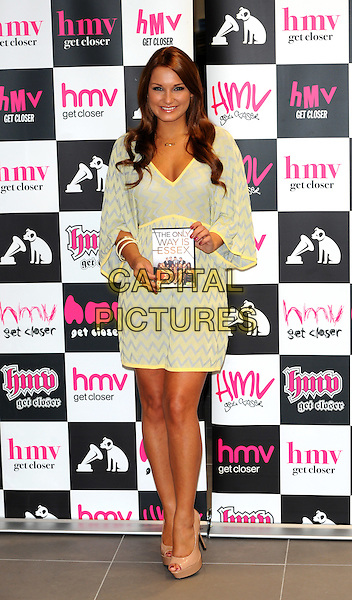 "Sam Faiers .Signing copies of the new ""The Only Way is Essex"" DVD, HMV, Westfield, Stratford, East London, England..29th September 2011.TOWIE full length blue yellow zig zag dress.CAP/CJ.©Chris Joseph/Capital Pictures."