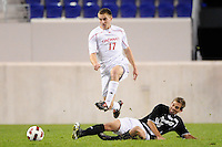 Matt Bahner (17) of the Cincinnati Bearcats jumps over a tackle by Michael Pereira (8) of the Providence Friars. The Providence Friars defeated the Cincinnati Bearcats 2-1 during the semi-finals of the Big East Men's Soccer Championship at Red Bull Arena in Harrison, NJ, on November 12, 2010.