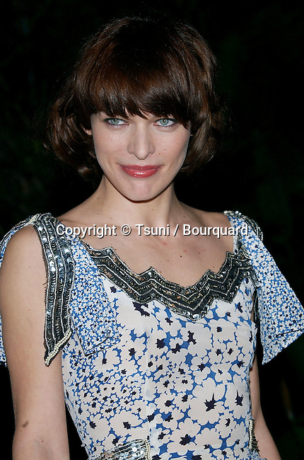 Milla Jovovich arriving at the Clive Davis Annual Party for the Grammys at the beverly Hills Hotel In Los Angeles. February 12, 2005.