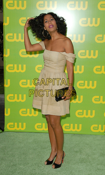 TRACEE ELLIS ROSS.The CW Launch Party held at Warner Brothers' Studios in Burbank, California, USA..September 18th, 2006.Ref: DVS.full length dress hand in hair beige cream black clutch purse off the shoulder.www.capitalpictures.com.sales@capitalpictures.com.©Debbie VanStory/Capital Pictures