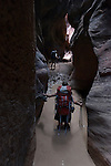 A pair of dirty girls find their way through Buckskin Gulch, AZ, the longest slot canyon in the world.