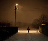 ZYRARDOW, POLAND, FEBRUARY 2012:.Megi at 4:35 in the morning on the way to catch train to Warsaw. About 500 thousand people commute everyday from other towns and villages to work in the Polish capital..(Photo by Piotr Malecki / Napo Images)..Luty 2012:.Megi o 4:35 w drodze do pociagu do Warszawy. Okolo 500 tysiecy osob dojezdza codziennie z innych miast do pracy w Warszawie.  .Fot: Piotr Malecki / Napo Images.