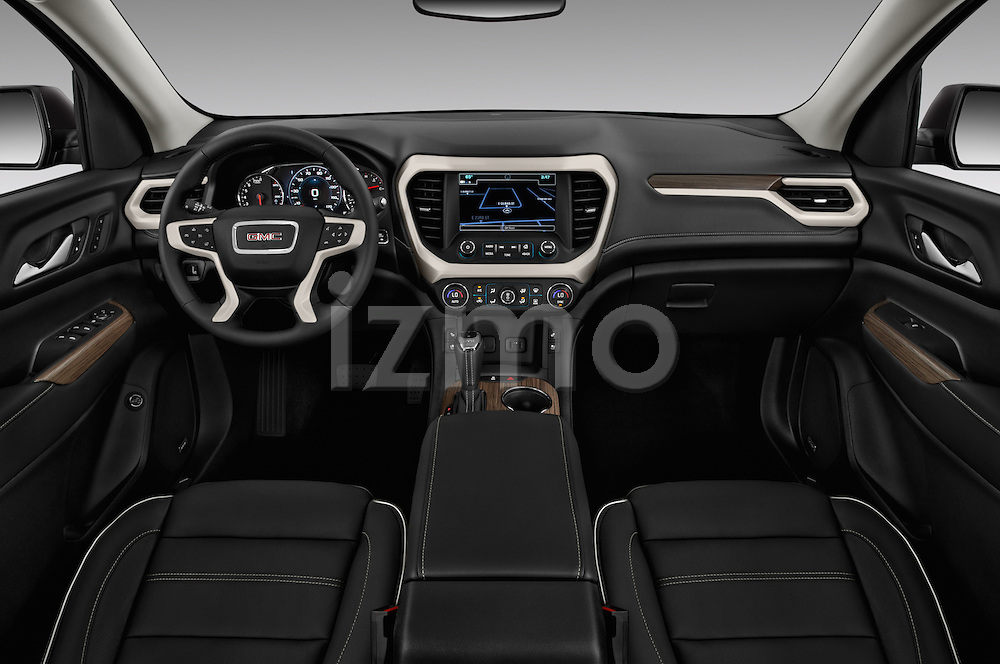 Stock photo of straight dashboard view of 2017 GMC Acadia Denali 5 Door SUV Dashboard