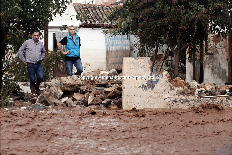 Pictured: Local people watch on as the flood lever rises.<br />Re: Five people have reportedly died and severe damage caused by heavy rain and flash flooding in the area of Mandra, near Athens, Greece. Wednesday 15 November 2017