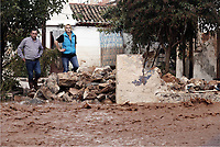 Pictured: Local people watch on as the flood lever rises.<br />