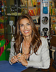 """Cast of Days Of Our Lives - Kristian Alfonso """"Hope Williams Brady"""" signs book """"Days Of Our Lives 50 Years"""" by Greg Meng - author & co-executive producer on October 27, 2015 at Books & Greetings, Northvale, New Jersey. (Photo by Sue Coflin/Max Photos)"""