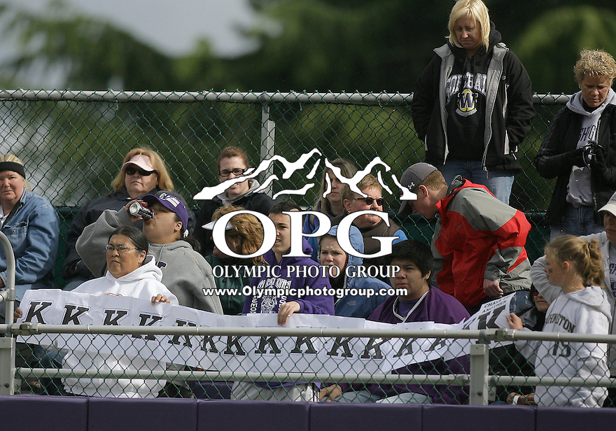 23 May 2010:  Washington Huskies fans kept a tally of starting pitcher Danielle Lawrie's strikeouts along the outfield fence against the University of North Carolina.  Washington defeated the University of North Carolina 2-1 in eight innings at Husky Softball Stadium in Seattle, WA to advance in the NCAA regional tournament.