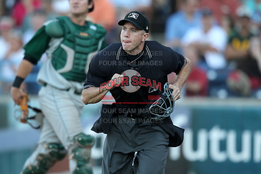 Umpire Alberto Ruiz during a game at Fifth Third Field in Comstock Park, Michigan;  August 18, 2010.  Photo By Mike Janes/Four Seam Images