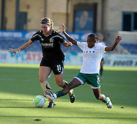 Red Stars midfielder Formiga (8) slide tackles the ball away from FC Gold Pride midfielder Kiki Bosio (11).  The FC Gold Pride defeated the Chicago Red Stars 3-2 at Toyota Park in Bridgeview, IL on August 22, 2010