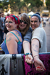 © Joel Goodman - 07973 332324 . 31/08/2013 . Rochdale , UK . Friends and manic The Feeling fans , show off their The Feeling tattoos - l-r Becci Snow (39 from Hull) , Natasha Ramsey (22 from Croydon) and Susan Harper (37 from Newcastle) . They all follow The Feeling all over the UK . The Feeling perform at a free gig in Rochdale. Photo credit : Joel Goodman