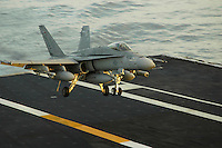 An F/A-18C Hornet recovers aboard USS Abraham Lincoln.