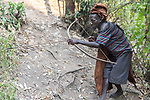 Batwa Pygmy Re-enacting Hunting