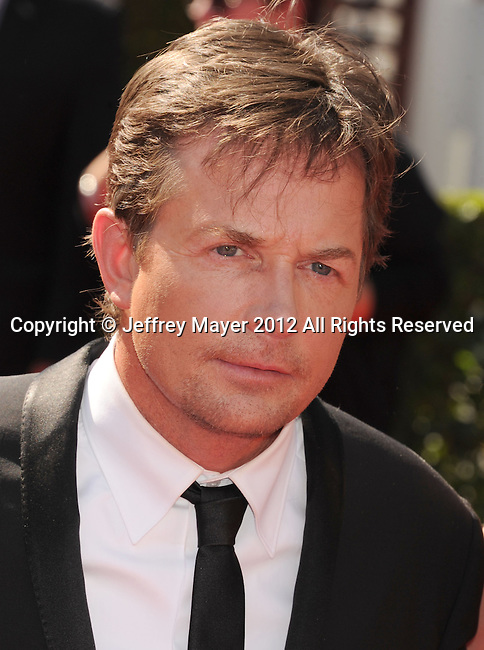 LOS ANGELES, CA - SEPTEMBER 15: Michael J. Fox arrives at the 2012 Primetime Creative Arts Emmy Awards at Nokia Theatre L.A. Live on September 15, 2012 in Los Angeles, California.