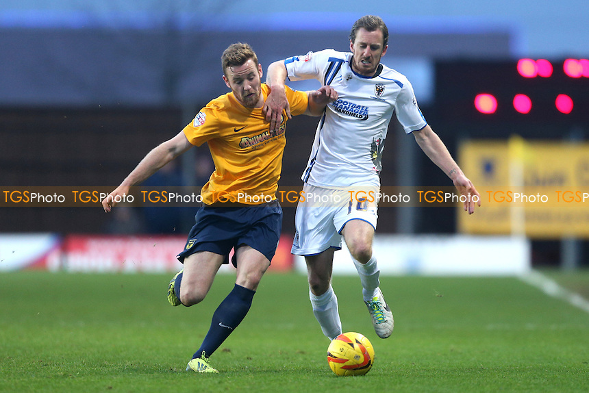 Deane Smalley of Oxford United tussles with Jack Midson of AFC Wimbledon - Oxford United vs AFC Wimbledon - Sky Bet League Two Football at the Kassam Stadium, Oxford - 01/02/14 - MANDATORY CREDIT: Simon Roe/TGSPHOTO - Self billing applies where appropriate - 0845 094 6026 - contact@tgsphoto.co.uk - NO UNPAID USE