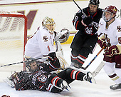Chris Donovan (NU - 23), John Muse (BC - 1), Mike McLaughlin (NU - 18), Philip Samuelsson (BC - 5) - The Boston College Eagles defeated the Northeastern University Huskies 5-1 on Saturday, November 7, 2009, at Conte Forum in Chestnut Hill, Massachusetts.