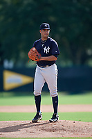 GCL Yankees West starting pitcher Anderson Reynoso (29) gets ready to deliver a pitch during the first game of a doubleheader against the GCL Braves on July 30, 2018 at Champion Stadium in Kissimmee, Florida.  GCL Yankees West defeated GCL Braves 7-5.  (Mike Janes/Four Seam Images)