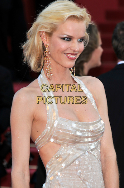 EVA HERZIGOVA.'Looking for Eric' screening.62nd International Cannes Film Festival.Cannes, France. 18th May 2009.Christophe half length halterneck silver beige sequined cleavage gold dangly earrings profile gold .CAP/PL.©Phil Loftus/Capital Pictures