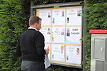 24/03/2020 in Pergine Valsugana, Italy. Most part of Europe is today on a sweeping confinement to try to slow down the spread of the Covid-19 Pandemic. A men updating the obituaries board.