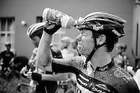 A Roompot rider tries to get the dirt out of his eyes while waiting during the 2nd neutralisation of the race<br /> <br /> 90th Schaal Sels 2015