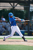 GCL Blue Jays left fielder D.J. Daniels (23) follows through on a swing during a game against the GCL Pirates on July 20, 2017 at Bobby Mattick Training Center at Englebert Complex in Dunedin, Florida.  GCL Pirates defeated the GCL Blue Jays 11-6 in eleven innings.  (Mike Janes/Four Seam Images)