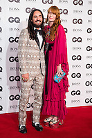 (L-R) Alessandro Michele and Florence Welch arrive for the GQ Men Of The Year Awards 2016 at the Tate Modern, London