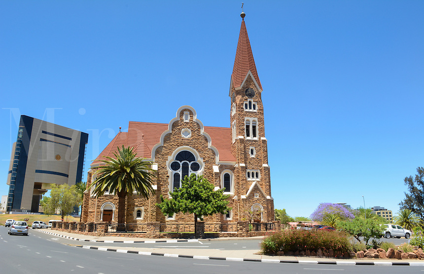 Windhoek Namibia Africa famous historical Christ Church cathedral and traffic with new Namibia National Museum in background