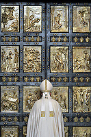"""Pope Francis opens a """"Holy Door"""" at St Peter's basilica to mark the start of the Jubilee Year of Mercy, on December 8, 2015"""