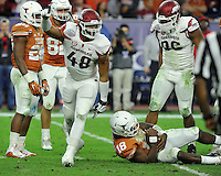 NWA Media/Michael Woods --12/29/2014-- w @NWAMICHAELW...University of Arkansas defensive end Deatrich Wise Jr celebrates after sacking Texas quadterback Tyrone Swoops in the 3rd quarter of the Texas Bowl Monday night at  NRG Stadium in Houston.