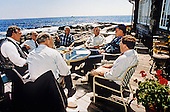United States President George H.W. Bush meets with senior national security advisors on sending U.S. Troops to Saudi Arabia at his home at Walkers Point in Kennebunkport, Maine August 22, 1990.<br /> Mandatory Credit: Carol T. Powers / White House via CNP