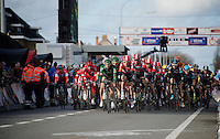 peloton crossing the finish line for the 1st of 3 local laps<br /> <br /> 67th Kuurne-Brussels-Kuurne 2015