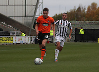 Keith Watson chased by Dougie Imrie in the St Mirren v Dundee United Clydesdale Bank Scottish Premier League match played at St Mirren Park, Paisley on 27.10.12.