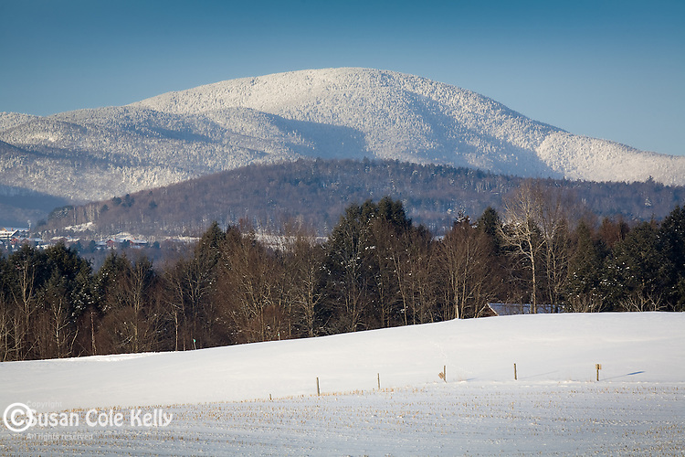 Winter snow blankets the mountains around Stowe, VT, USA