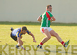 St Michaels Foilmore's Johnny Clifford breaks free from the tackle of Kenmare's Darragh Crowley in their Senior Championship clash in Foilmore on Saturday last.  Foilmore 1-12 Kenmare District 0-15.
