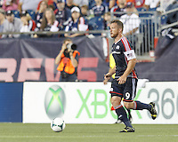 New England Revolution midfielder Chad Barrett (9) brings the ball forward.  In a Major League Soccer (MLS) match, the New England Revolution (dark blue) defeated Philadelphia Union (light blue), 5-1, at Gillette Stadium on August 25, 2013.