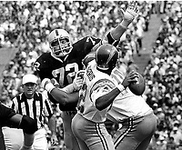 Raiders John Matuszak rushes San Diego Charger  James Harris...(1977 photo/Ron Riesterer)
